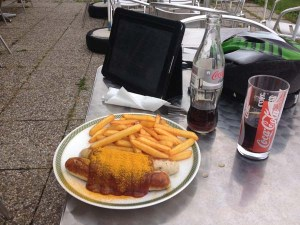 A healthy... portion of currywurst and chips